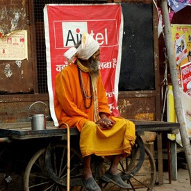 holy-man-in-front-of-airtel-shop-in-india
