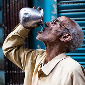 man-drinking-water-in-india